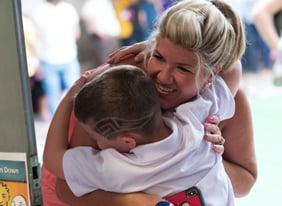 international school-parent-hugging-child