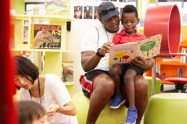 international-school-bangkok-parent-reading-with-child